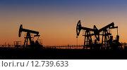 Купить «Нефтяные насосы на фоне вечернего неба», фото № 12739633, снято 12 мая 2015 г. (c) bashta / Фотобанк Лори