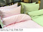Купить «Pillows on the bed in bedroom», фото № 12739721, снято 24 сентября 2015 г. (c) Володина Ольга / Фотобанк Лори