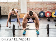 Купить «Two fit people working out at crossfit session», фото № 12742613, снято 14 мая 2015 г. (c) Wavebreak Media / Фотобанк Лори