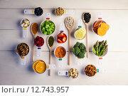 Купить «Portion cups and spoons of healthy ingredients», фото № 12743957, снято 1 января 2008 г. (c) Wavebreak Media / Фотобанк Лори