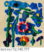 """Купить «Детская поделка из пластилина на бумаге """"Море""""», фото № 12745777, снято 24 сентября 2015 г. (c) Наталья Горкина / Фотобанк Лори"""