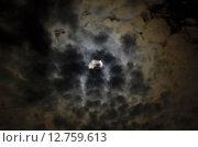 Купить «Луна среди туч», фото № 12759613, снято 1 сентября 2015 г. (c) Карданов Олег / Фотобанк Лори