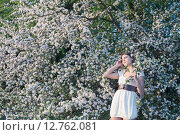 Купить «Beautiful young girl on background flowering apple-tree», фото № 12762081, снято 11 мая 2015 г. (c) Майя Крученкова / Фотобанк Лори