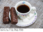 Купить «Чашка кофе и шоколадные вафли», фото № 12762193, снято 16 сентября 2015 г. (c) Алёшина Оксана / Фотобанк Лори