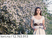 Купить «Beautiful young girl on background flowering apple-tree», фото № 12763913, снято 11 мая 2015 г. (c) Майя Крученкова / Фотобанк Лори