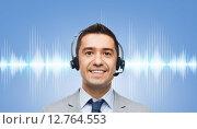 Купить «businessman in headset over sound wave or diagram», фото № 12764553, снято 29 января 2015 г. (c) Syda Productions / Фотобанк Лори