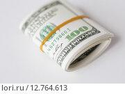 Купить «close up of dollar money packet tied with rubber», фото № 12764613, снято 30 июля 2015 г. (c) Syda Productions / Фотобанк Лори