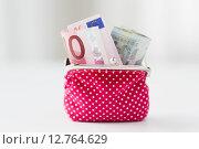 Купить «close up of euro paper money in pink wallet», фото № 12764629, снято 30 июля 2015 г. (c) Syda Productions / Фотобанк Лори