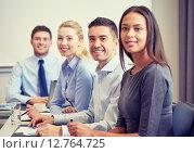 Купить «group of smiling businesspeople meeting in office», фото № 12764725, снято 25 октября 2014 г. (c) Syda Productions / Фотобанк Лори