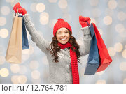 Купить «happy woman in winter clothes with shopping bags», фото № 12764781, снято 30 октября 2011 г. (c) Syda Productions / Фотобанк Лори