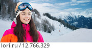 Купить «happy young woman in ski goggles over mountains», фото № 12766329, снято 7 февраля 2015 г. (c) Syda Productions / Фотобанк Лори