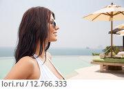 Купить «smiling young woman with sunglasses on beach», фото № 12766333, снято 6 августа 2015 г. (c) Syda Productions / Фотобанк Лори