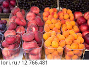 Купить «close up of peaches and apricots at street market», фото № 12766481, снято 27 июля 2015 г. (c) Syda Productions / Фотобанк Лори