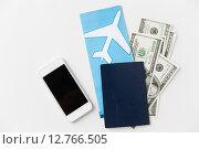 Купить «air ticket, money, smartphone and passport», фото № 12766505, снято 30 июля 2015 г. (c) Syda Productions / Фотобанк Лори