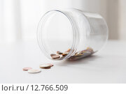 Купить «close up of euro coins in glass jar on table», фото № 12766509, снято 30 июля 2015 г. (c) Syda Productions / Фотобанк Лори
