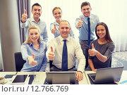 Купить «business people showing thumbs up in office», фото № 12766769, снято 25 октября 2014 г. (c) Syda Productions / Фотобанк Лори