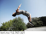 Купить «sporty young man jumping in summer park», фото № 12767321, снято 25 августа 2015 г. (c) Syda Productions / Фотобанк Лори