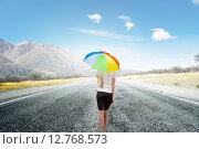 Купить «Businesswoman with umbrella», фото № 12768573, снято 24 марта 2014 г. (c) Sergey Nivens / Фотобанк Лори