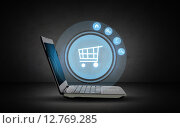 Купить «laptop computer with shopping cart icon projection», фото № 12769285, снято 22 мая 2019 г. (c) Syda Productions / Фотобанк Лори