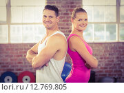 Купить «Fit couple smiling in crossfit», фото № 12769805, снято 14 мая 2015 г. (c) Wavebreak Media / Фотобанк Лори