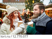 Купить «happy couple drinking coffee on old town street», фото № 12770077, снято 11 декабря 2014 г. (c) Syda Productions / Фотобанк Лори
