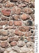 Купить «Грубая каменная стена из природного камня  в средневековом замке», фото № 12777845, снято 17 октября 2018 г. (c) FotograFF / Фотобанк Лори