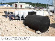 Купить «Емкости для хранения топлива на промышленном предприятии», эксклюзивное фото № 12795617, снято 7 декабря 2019 г. (c) Валерий Акулич / Фотобанк Лори