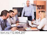 Купить «upset business team in office», фото № 12804297, снято 18 февраля 2019 г. (c) Яков Филимонов / Фотобанк Лори