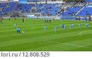 Купить «Football team players warming-up before important match», видеоролик № 12808529, снято 5 апреля 2015 г. (c) Данил Руденко / Фотобанк Лори