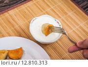 Купить «To dip the fried dumplings in sour cream», фото № 12810313, снято 26 сентября 2015 г. (c) Алёшина Оксана / Фотобанк Лори