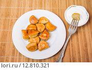 Купить «To dip the fried dumplings in sour cream», фото № 12810321, снято 26 сентября 2015 г. (c) Алёшина Оксана / Фотобанк Лори