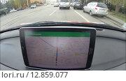 Купить «UFA, RUSSIA - SEPTEMBER 22, 2015: A car driver using a Google Navigator application on Android device Samsung. Google Navigator is a most popular web mapping service for mobile provided by Google inc.», видеоролик № 12859077, снято 22 сентября 2015 г. (c) Mikhail Erguine / Фотобанк Лори