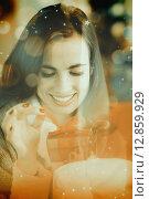 Купить «Composite image of smiling brunette opening a gift on christmas day», фото № 12859929, снято 21 сентября 2018 г. (c) Wavebreak Media / Фотобанк Лори
