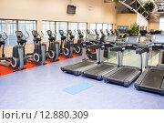 Купить «Collection of treadmills and exercise bikes», фото № 12880309, снято 17 июля 2015 г. (c) Wavebreak Media / Фотобанк Лори