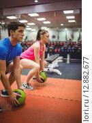 Купить «Fit couple working out in weights room», фото № 12882677, снято 16 июля 2015 г. (c) Wavebreak Media / Фотобанк Лори