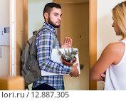 Купить «Young couple separating after quarrel», фото № 12887305, снято 27 марта 2019 г. (c) Яков Филимонов / Фотобанк Лори
