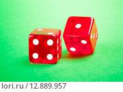 Купить «two red dices», фото № 12889957, снято 17 июня 2019 г. (c) PantherMedia / Фотобанк Лори