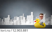 Купить «Businessman on rubber duck», фото № 12903881, снято 18 октября 2019 г. (c) Sergey Nivens / Фотобанк Лори