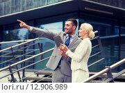 Купить «smiling businessmen with tablet pc outdoors», фото № 12906989, снято 19 августа 2014 г. (c) Syda Productions / Фотобанк Лори