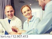 Купить «business people with papers meeting in office», фото № 12907413, снято 25 октября 2014 г. (c) Syda Productions / Фотобанк Лори