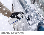Купить «closeup of man hand with lock door de-icer», фото № 12907493, снято 16 января 2014 г. (c) Syda Productions / Фотобанк Лори