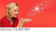 Купить «woman sending stars from palms of her hands», фото № 12907901, снято 7 октября 2012 г. (c) Syda Productions / Фотобанк Лори