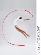 Купить «Jumping woman», фото № 12908541, снято 14 мая 2015 г. (c) Raev Denis / Фотобанк Лори