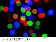 Купить «colorful bright night lights over black background», фото № 12911517, снято 11 сентября 2015 г. (c) Syda Productions / Фотобанк Лори
