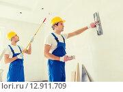 Купить «group of builders with tools indoors», фото № 12911709, снято 25 сентября 2014 г. (c) Syda Productions / Фотобанк Лори