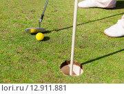Купить «close up of man with club and ball playing golf», фото № 12911881, снято 30 августа 2015 г. (c) Syda Productions / Фотобанк Лори