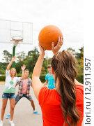 Купить «group of happy teenagers playing basketball», фото № 12911957, снято 10 августа 2014 г. (c) Syda Productions / Фотобанк Лори