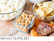 close up of fast food snacks on wooden table. Стоковое фото, фотограф Syda Productions / Фотобанк Лори