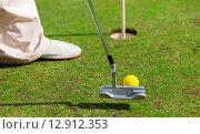 Купить «close up of man with club and ball playing golf», фото № 12912353, снято 30 августа 2015 г. (c) Syda Productions / Фотобанк Лори