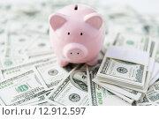 Купить «close up of usa dollar money and piggy bank», фото № 12912597, снято 30 июля 2015 г. (c) Syda Productions / Фотобанк Лори